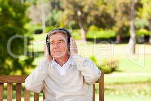 Retired man listening to some music