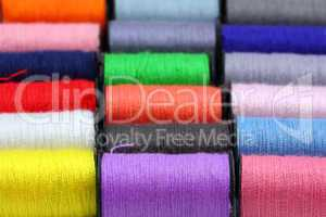 lot of colored thread spools