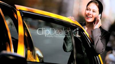 Businesswoman by City Taxi with Cell Phone