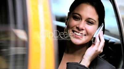 Female in Taxi with Cell Phone