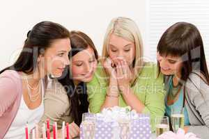 Birthday party - surprised woman getting present