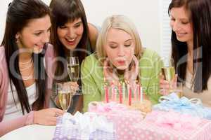 Birthday party - woman blowing candle on cake
