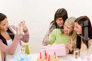 Birthday party - cheerful woman take photo with camera