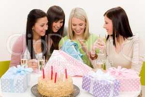 Birthday party - woman unwrap present, celebrating