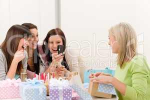 Birthday party - cheerful woman take photo