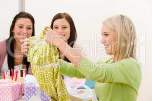 Birthday party - woman unwrap present, surprise