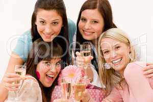 Birthday party celebration - four woman toast with champagne