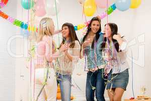Birthday party celebration - four woman with confetti