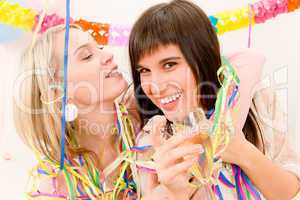 Birthday party celebration - two woman with confetti have fun
