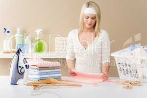 Laundry ironing - woman folding clothes