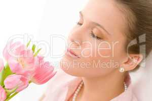 Fashion - young romantic woman smell spring tulips