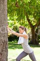 Woman doing her stretches in the park