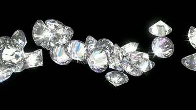 Large diamonds or gems rolling over with slow motion