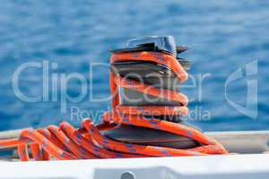 Winch with red rope on yacht