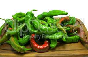 Hot peppers on wooden kitchen board