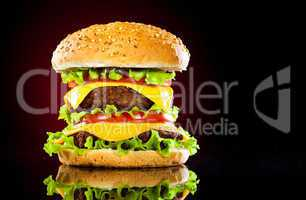 Tasty and appetizing hamburger on a darkly red