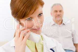 Doctor office - female physician make phone call
