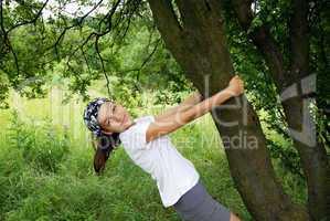 Teenage girl by tree