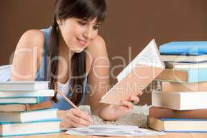 Home study - woman teenager write notes