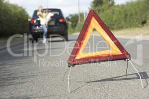 Mother And Daughter Broken Down On Country Road With Hazard Warn