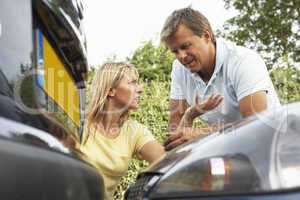 Man And Woman Having Argument After Traffic Accident