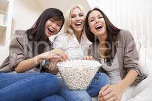 Three Beautiful Women Friends Eating Popcorn Watching Movie at H