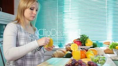 Pregnant woman eating a banana
