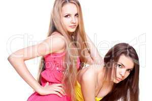 two beautiful women in a colored dress