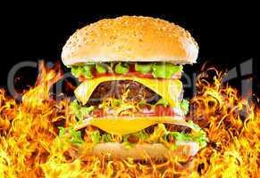Tasty hamburger on fire on a dark