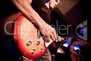 musician plays a guitar