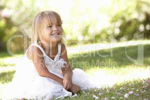 Young girl posing in park