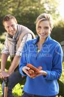 Young couple posing in garden