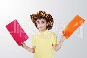 boy with colored paper in his hands