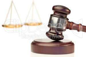 Brown gavel and scale of justice