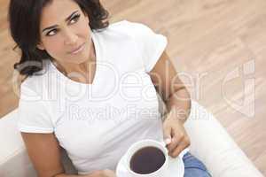 Beautiful Young Woman Drinking Tea or Coffee