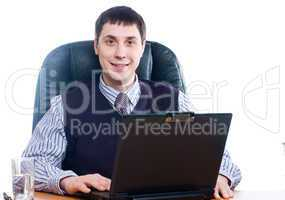 Portrait of a young businessman with laptop