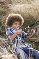 Young Boy Fishing At Seaside
