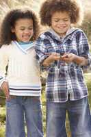 Children Holding Worm Outdoors