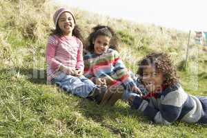 Young Children Sitting Outside In Caravan Park