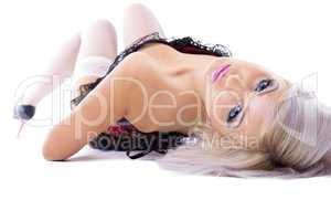 Beauty sexy blonde in corset lay on white