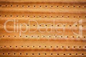 leather stitched by threads