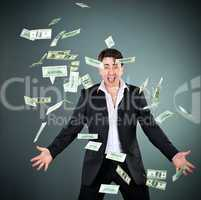 man in a suit throws money