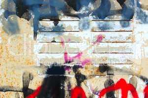 graffiti on rusty surface
