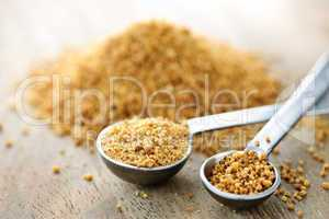 Coconut palm sugar in measuring spoons