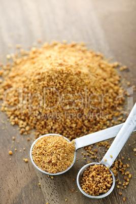 Coconut palm sugar in measuring spoons