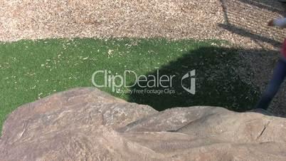 Girl Rock Climbing At Playground