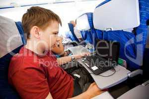 boy flies in the plane