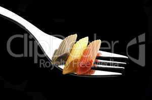 italian penne pasta on a fork