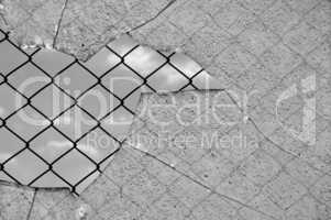 broken glass and wired fence