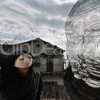 masked evil figure behind threaded window